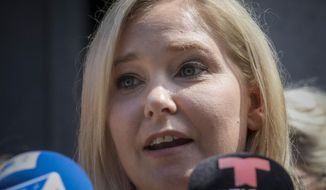 Virginia Roberts Giuffre, a sexual assault victim, speak during a press conference outside a Manhattan court where sexual victims, on invitation of a judge, addressed a hearing after the accused Jeffrey Epstein killed himself before facing sex trafficking charges, Tuesday Aug. 27, 2019, in New York. (AP Photo/Bebeto Matthews)