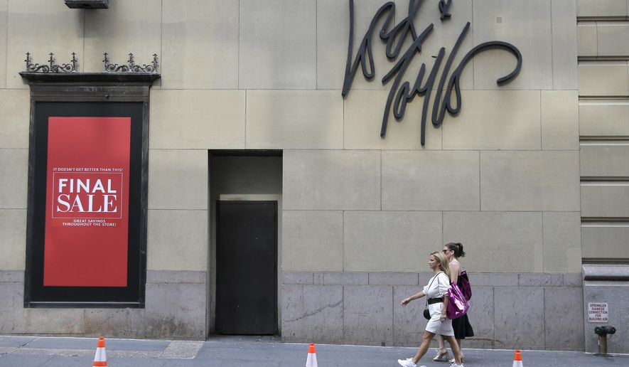 FILE - In this Oct. 4, 2018, file photo signs advertising the closing of a Lord & Taylor store are displayed in New York, Thursday. Lord & Taylor, one of the nation's oldest department stores, is being sold for $100 million. The retailer's owner, Hudson's Bay Co., says it reached a deal with online rental clothing company Le Tote Inc.  (AP Photo/Seth Wenig, File)