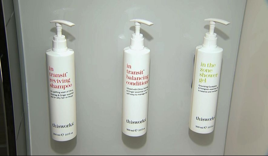 This image made from video shows bottles of shampoo, conditioner and shower gel that will replace smaller bottles of them by 2021, filmed at Marriott's headquarters in Bethesda, Md., Tuesday, Aug. 27, 2019. Marriott International, the world's largest hotel chain, said Wednesday it will eliminate small plastic bottles of shampoo, conditioner and bath gel from its hotel rooms worldwide by December 2020. They'll be replaced with larger bottles or wall-mounted dispensers, depending on the hotel. (AP Photo/Dan Huff)