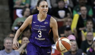 FILE - In this Aug. 26, 2018, file photo, Phoenix Mercury's Diana Taurasi brings the ball up against the Seattle Storm during the first half of a WNBA basketball playoff game in Seattle. Taurasi admits she's been fortunate throughout her basketball career not to have been injured often. Until this season, she's only had to really miss games one other time due to injuries and that was in 2012 when she sat out the first 16 games to recover from hip flexor and ankle injuries. This year's been different. She missed the first part of the season recovering from back surgery. After she returned for one game in Connecticut, she tweaked her hamstring and didn't come back until last week. (AP Photo/Elaine Thompson, File)