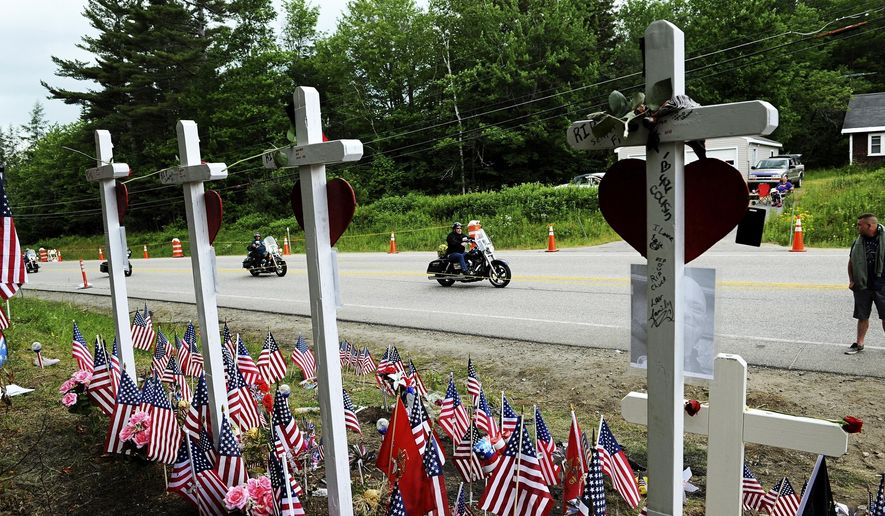 FILE - In this July 6, 2019 file photo, motorcyclists participate in a ride to remember seven bikers killed in a June collision with a pickup truck at the site in Randolph, N.H. New Hampshire's Division of Motor Vehicles plans to suspend the licenses of nearly 4,000 drivers as part of a review following the deadly collision. Gov. Chris Sununu said the review released Wednesday, Aug. 28, led authorities to eliminate a backlog of notifications that dated back to July 2016. (Paul Hayes/Caledonian-Record via AP, File)