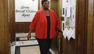 "In this Friday, Aug. 23, 2019, photo, New York Police Department Deputy Chief Judith Harrison, in charge of the Special Victims Division, walks through the NYPD Detective Bureau in the Bronx borough of New York. The NYPD's ""victim-centered"" approach to sex crimes is translating into more privacy for accusers and greater transparency with the department's crime statistics. (AP Photo/Richard Drew)"