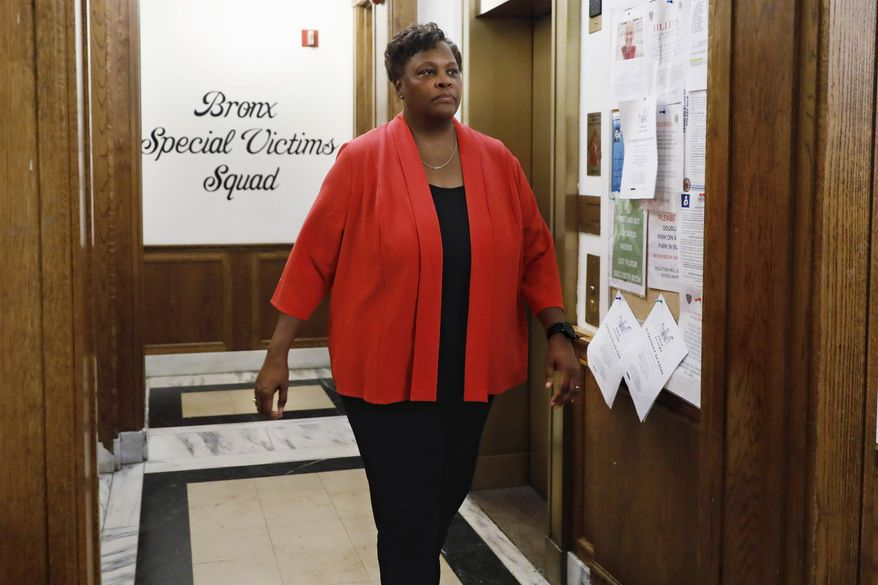 """In this Friday, Aug. 23, 2019, photo, New York Police Department Deputy Chief Judith Harrison, in charge of the Special Victims Division, walks through the NYPD Detective Bureau in the Bronx borough of New York. The NYPD's """"victim-centered"""" approach to sex crimes is translating into more privacy for accusers and greater transparency with the department's crime statistics. (AP Photo/Richard Drew)"""