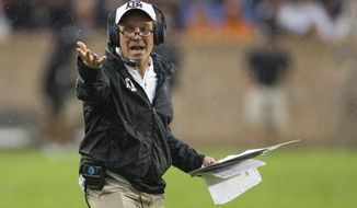 FILE - In this Sept. 8, 2018, file photo, Texas A&M head coach Jimbo Fisher reacts after a call during the first half of an NCAA college football game against Clemson, in College Station, Texas. Texas A&M faces four of the top eight teams from the season-ending AP poll. The Aggies play three of those games on the road, including visits to Georgia and LSU the last two weeks of the season. (AP Photo/Sam Craft, File)