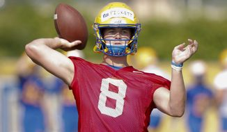 FILE - This Aug. 2, 2019, file photo shows Pittsburgh quarterback Kenny Pickett as he passes in a drill during an NCAA college football practice in Pittsburgh. How far Pitt goes toward repeating as ACC Coastal Division champions will rely heavily on if quarterback Kenny Pickett and new offensive coordinator Mark Whipple can revive a dormant passing game. (AP Photo/Keith Srakocic, File)