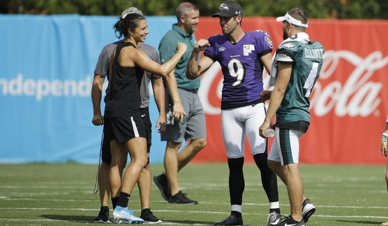 Baltimore Ravens' Justin Tucker (9) and Philadelphia Eagles' Jake Elliott meet with United States soccer player Carli Lloyd after she kicked a field goal following the Philadelphia Eagles and the Baltimore Ravens joint NFL football practice in Philadelphia, Tuesday, Aug. 20, 2019. (AP Photo/Matt Rourke) ** FILE **