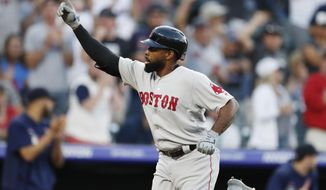 Boston Red Sox's Jackie Bradley Jr. gestures to the crowd as he circles the bases on a solo home run off Colorado Rockies starting pitcher Rico Garcia during the second inning of a baseball game Tuesday, Aug. 27, 2019, in Denver. (AP Photo/David Zalubowski)