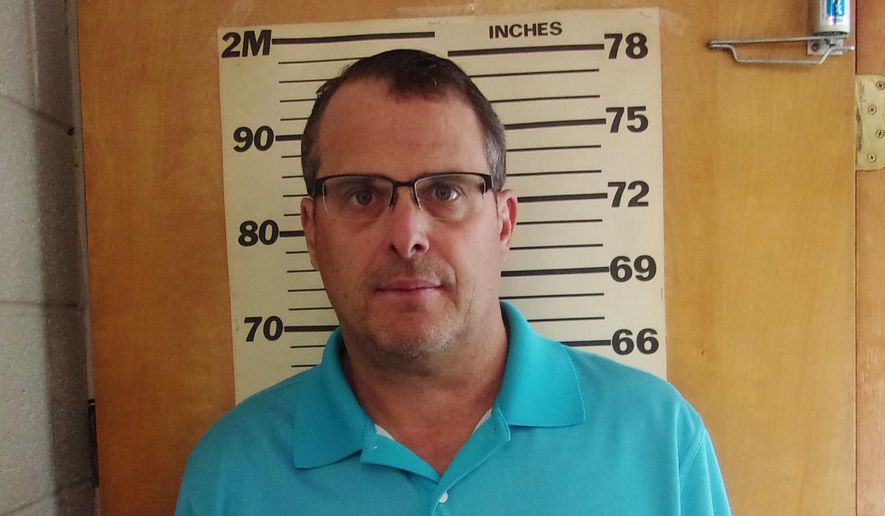 This undated booking photo provided by the Glen Dale Police Department shows West Virginia state Sen. Mike Maroney. He has been charged with soliciting a prostitute. The Republican lawmaker turned himself in and was arraigned Wednesday morning, Aug. 28, 2019, a Marshall County court clerk said. He has pleaded not guilty and paid a $4,500 bond. (Glen Dale Police Department via AP)