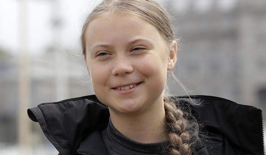 """FILE - In this Aug. 14, 2019 file photo, Climate change activist Greta Thunberg addresses the media during a news conference in Plymouth, England.  Thunberg has crossed the Atlantic on a zero-emissions sailboat to attend a conference on global warming. On Wednesday, Aug. 28,  before dawn,  Thunberg tweeted, """"Land!! The lights of Long Island and New York City ahead."""" (AP Photo/Kirsty Wigglesworth)"""