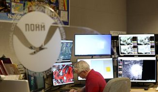In this file photo, senior hurricane specialist Stacy Stewart monitors the progress of Tropical Storm Dorian at the National Hurricane Center, Tuesday, Aug. 27, 2019, in Miami. (AP Photo/Lynne Sladky)