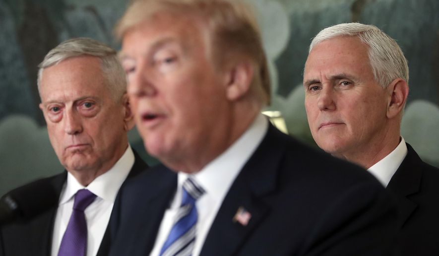 """FILE - In this March 23, 2018 file photo, Defense Secretary Jim Mattis, left, and Vice President Mike Pence, right, listen to President Donald Trump, center, speaks in the Diplomatic Room of the White House in Washington.  Mattis warns bitter political divisions have pushed American society to the """"breaking point"""" in his most extensive public remarks since he resigned in protest from the Trump administration.  (AP Photo/Pablo Martinez Monsivais)"""