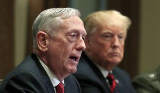 """In this Oct. 23, 2018, file photo, then-Defense Secretary Jim Mattis speaks beside President Donald Trump, during a briefing with senior military leaders in the Cabinet Room at the White House in Washington. Mattis warns bitter political divisions have pushed American society to the """"breaking point"""" in his most extensive public remarks since he resigned in protest from the Trump administration.  (AP Photo/Manuel Balce Ceneta) ** FILE **"""