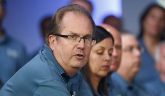 FILE - In this July 16, 2019, file photo, Gary Jones, United Auto Workers President, speaks during the opening of their contract talks with Fiat Chrysler Automobiles in Auburn Hills, Mich. On Wednesday, Aug. 28, 2019, an FBI spokesperson confirmed federal agents are searching Jones' suburban Detroit home apparently another step in an investigation of union corruption. (AP Photo/Paul Sancya, File)