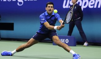Novak Djokovic, of Serbia, returns to Juan Ignacio Londero, of Argentina, during the second round of the U.S. Open tennis tournament in New York, Wednesday, Aug. 28, 2019. (AP Photo/Charles Krupa)