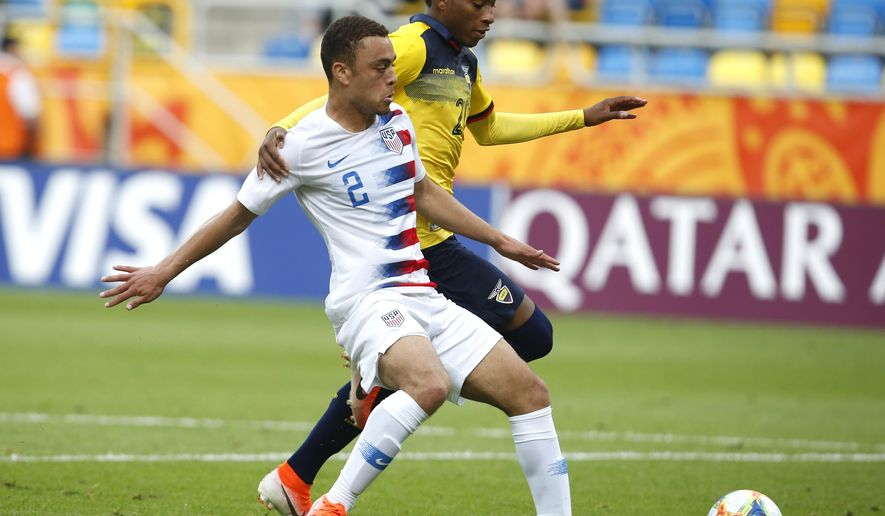 FILE - In this June 8, 2019, file photo, United States' Sergino Dest, left, and Ecuador's Gonzalo Plata challenge for the ball during a quarterfinal soccer match at the U20 World Cup in Gdynia, Poland. Defender Sergiño Dest and midfielder Paxton Pomykal are joining the U.S. national team for the first time, among 26 players on the roster for exhibitions against Mexico and Uruguay. (AP Photo/Darko Vojinovic, File)
