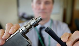 The Food and Drug Administration is investigating whether e-cigarettes are linked to seizures and other neurlogical issues such as fainting or tremors. The agency received 127 reports from 2010 to 2019 of people who said they had seizures, tremors or fainted. (ASSOCIATED PRESS)