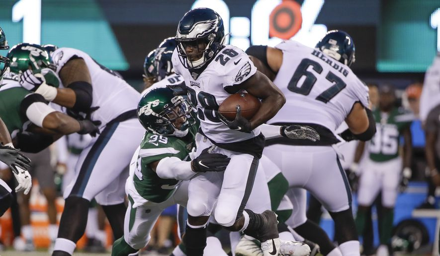 New York Jets' Sojourn Shelton (39) tackles Philadelphia Eagles' Wendell Smallwood (28) during the first half of a preseason NFL football game Thursday, Aug. 29, 2019, in East Rutherford, N.J. (AP Photo/Matt Rourke) **FILE**
