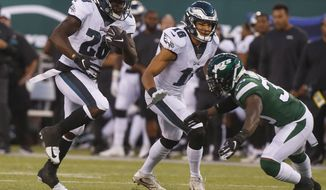 Philadelphia Eagles' Wendell Smallwood (28) rushes past New York Jets' Doug Middleton (36) during the first half of a preseason NFL football game Thursday, Aug. 29, 2019, in East Rutherford, N.J. (AP Photo/Jim McIsaac) ** FILE **