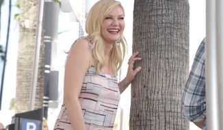 """Actress Kirsten Dunst, who starred in films """"Marie Antoinette,"""" """"Bring it On,"""" and """"Spider-Man,"""" attends a ceremony honoring her with a star on the Hollywood Walk of Fame on Thursday, Aug. 29, 2019, in Los Angeles. (Richard Shotwell/Invision/AP)"""