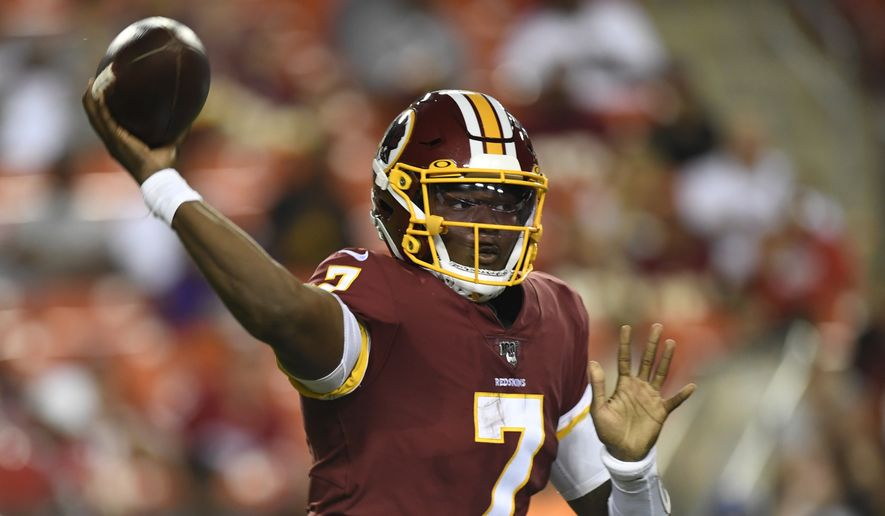 Washington Redskins quarterback Dwayne Haskins (7) throws the ball during the first half of an NFL preseason football game against the Baltimore Ravens at FedEx Field in Landover, Md., Thursday, Aug. 29, 2019. (AP Photo/Susan Walsh)