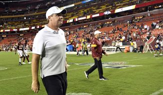 Washington Redskins head coach Jay Gruden walks off of the field following an NFL preseason football game against the Baltimore Ravens at FedEx Field in Landover, Md., Thursday, Aug. 29, 2019. The Ravens beat the Redskins, 20-7. (AP Photo/Susan Walsh)