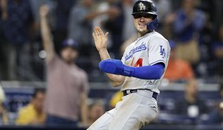 Los Angeles Dodgers' Enrique Hernandez reacts after scoring during the 10th inning of the team's baseball game against the San Diego Padres on Wednesday, Aug. 28, 2019, in San Diego. (AP Photo/Gregory Bull)