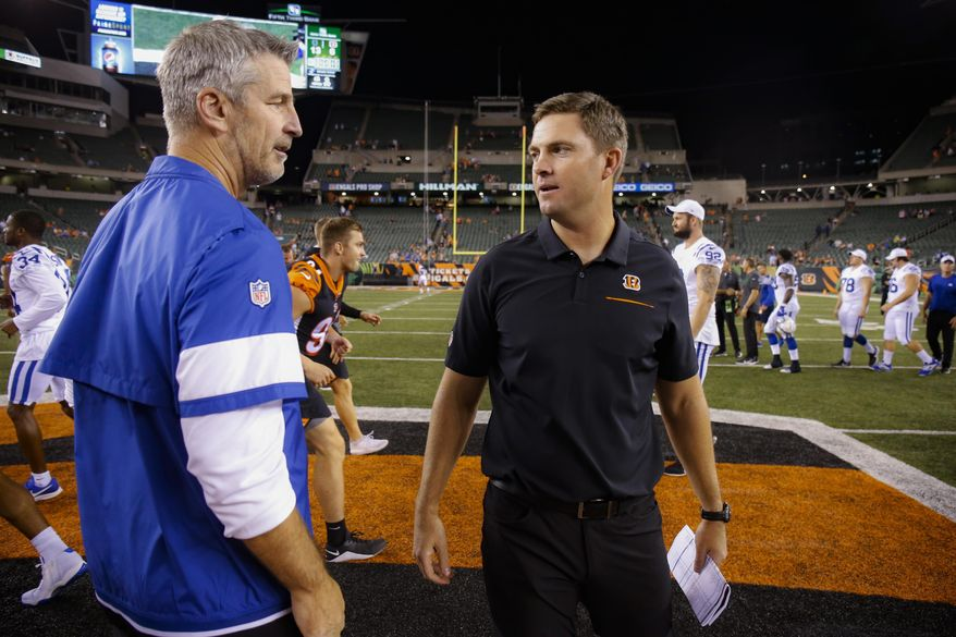 Cincinnati Bengals coach Zac Taylor, right, meets with Indianapolis Colts coach Frank Reich after an NFL preseason football game Thursday, Aug. 29, 2019, in Cincinnati. (AP Photo/Gary Landers)