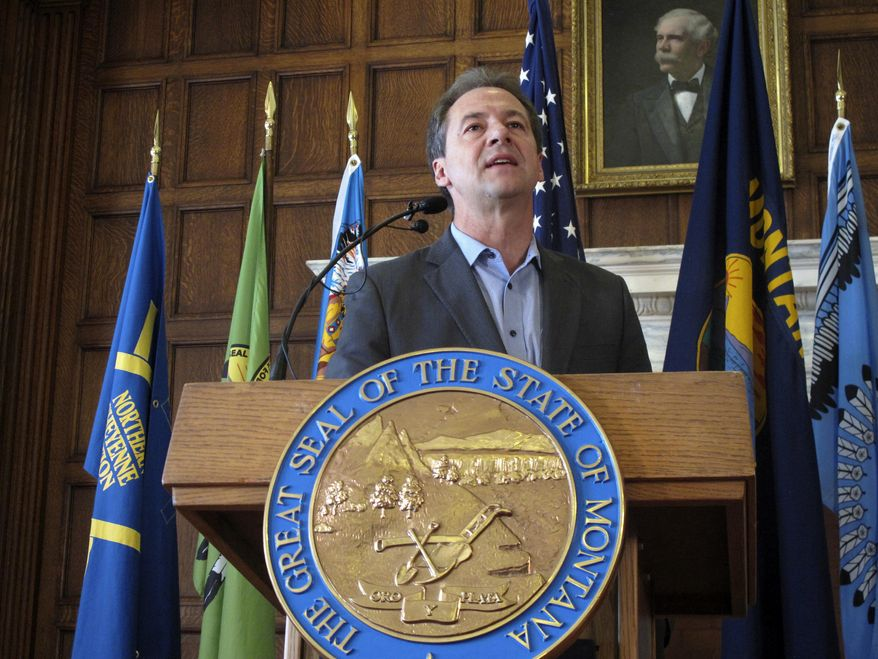 """FILE - In this June 8, 2018 file photo, Montana Gov. Steve Bullock speaks before signing an executive order requiring major state government contractors to disclose any contributions to so-called """"dark money"""" groups that aren't required to disclose their donors under federal election laws at the Capitol in Helena.  A conservative advocacy group is challenging Bullock's executive order that requires organizations who receive state contracts to report political contributions that exceed $2,500, even if those disclosures aren't required under federal election laws. The federal court challenge was filed Tuesday, Aug. 27, 2019 by the Illinois Opportunity Group. (AP Photo/Matt Volz, File)"""