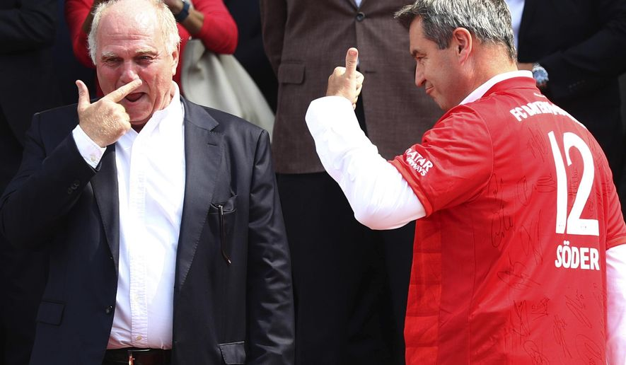 Bayern Munich President Uli Hoeness, left, laughes besides Bavarian State Governor Markus Soeder during a reception for his soccer clubnin Munich, Germany, Wednesday, Aug. 28, 2019. (AP Photo/Matthias Schrader)