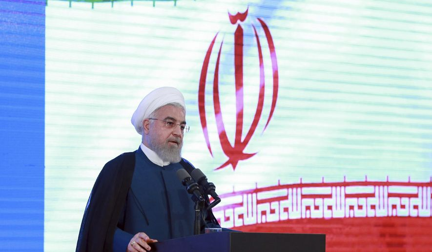 In this photo released by the official website of the office of the Iranian Presidency, President Hassan Rouhani speaks in a ceremony in Tehran, Iran, Tuesday, Aug. 27, 2019. Rouhani back-pedaled Tuesday on possible talks with Donald Trump, saying the U.S. president must first lift sanctions imposed on Tehran, otherwise a meeting between the two would be a mere photo op. (Iranian Presidency Office via AP)