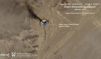 This satellite image from Planet Labs Inc., which has been annotated by experts at the James Martin Center for Nonproliferation Studies at Middlebury Institute of International Studies, shows a fire at a rocket launch pad at the Imam Khomeini Space Center in Iran's Semnan province, Thursday, Aug. 29, 2019. The satellite image released Thursday shows the smoldering remains of a rocket at a Iran space center that was to conduct a U.S.-criticized satellite launch. (Planet Labs Inc, Middlebury Institute of International Studies via AP)