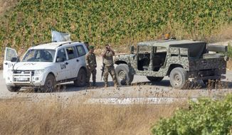 Lebanese soldiers with U.N officials patrol in the southern Lebanese village of Aitaroun along the Israel-Lebanon border, Israel, Tuesday, Aug. 27, 2019. Israeli forces along the border with Lebanon are on high alert, raising fears of a repeat of the 2006 war. (AP Photo/Ariel Schalit)
