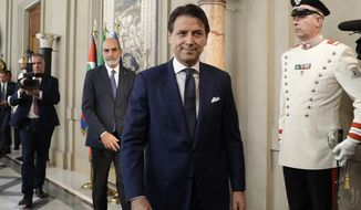 Designate premier Giuseppe Conte leaves after a meeting with President Sergio Mattarella at Rome's Quirinale presidential palace, Thursday, Aug. 29, 2019. Italy's president has given the recently resigned premier, Giuseppe Conte, a fresh mandate to see if he can cobble together a new government backed by the populist 5-Star Movement and center-left Democrats. (AP Photo/ Andrew Medichini)