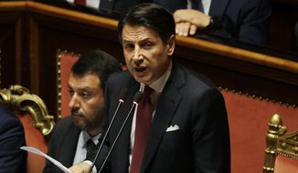 In this Tuesday, Aug. 20, 2019, file photo, Italian Premier Giuseppe Conte, right, is flanked by Deputy-Premier Matteo Salvini as he addresses the Senate in Rome. Italy's populist 5-Star Movement has asked, Wednesday, Aug. 28, 2019, the nation's president to give caretaker Premier Giuseppe Conte the mandate to form a new coalition government, a week after the one he led for 14 months collapsed. (AP Photo/Gregorio Borgia, File)