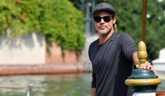 Actor Brad Pitt arrives at the Lido Beach for the 76th edition of the Venice Film Festival, in Venice, Italy, Thursday, Aug. 29, 2019. The Venice Film Festival runs from Aug. 28 to Sept. 7. (Ettore Ferrari/ANSA via AP)