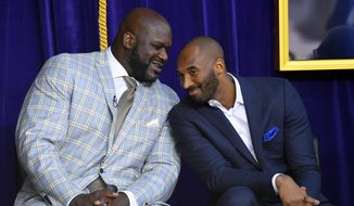 """In this March 24, 2017, file photo, Shaquille O'Neal, left, and Kobe Bryant chat at the unveiling of a statue of O'Neal in front of the Staples Center in Los Angeles. Bryant downplayed talk of a reignited feud with Shaquille O'Neal, saying there is """"nothing new"""" that has been said recently between the former teammates. Bryant had recently said that if O'Neal had worked harder, they could have won 12 rings together with the Los Angeles Lakers. O'Neal fired back on social media that they could have won more if Bryant had passed him the ball more often. But Bryant said Thursday, Aug. 29, 2019, during a visit to the U.S. Open tennis tournament that the comments don't mean they are fighting again. (AP Photo/Mark J. Terrill, File) **FILE**"""