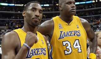 """FILE - In this May 4, 2002, file photo, Los Angeles Lakers' Kobe Bryant, left, and Shaquille O'Neal celebrate after winning Game 5 of the Western Conference semifinals against the San Antonio Spurs, in Los Angeles. Bryant downplayed talk of a reignited feud with Shaquille O'Neal, saying there is """"nothing new"""" that has been said recently between the former teammates. Bryant had recently said that if O'Neal had worked harder, they could have won 12 rings together with the Los Angeles Lakers. O'Neal fired back on social media that they could have won more if Bryant had passed him the ball more often. But Bryant said Thursday, Aug. 29, 2019, during a visit to the U.S. Open tennis tournament that the comments don't mean they are fighting again. (AP Photo/Mark J. Terrill)"""