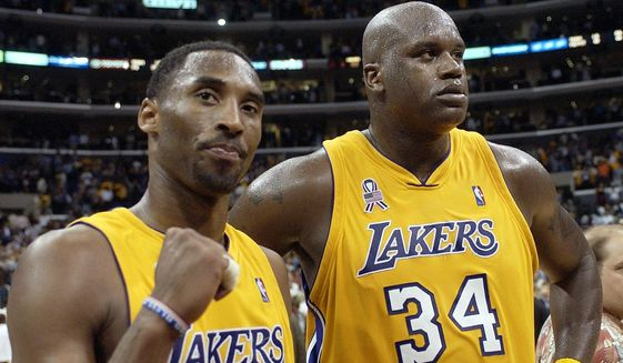 "In this May 4, 2002, file photo, Los Angeles Lakers' Kobe Bryant, left, and Shaquille O'Neal celebrate after winning Game 5 of the Western Conference semifinals against the San Antonio Spurs, in Los Angeles. Bryant downplayed talk of a reignited feud with Shaquille O'Neal, saying there is ""nothing new"" that has been said recently between the former teammates. Bryant had recently said that if O'Neal had worked harder, they could have won 12 rings together with the Los Angeles Lakers. O'Neal fired back on social media that they could have won more if Bryant had passed him the ball more often. But Bryant said Thursday, Aug. 29, 2019, during a visit to the U.S. Open tennis tournament that the comments don't mean they are fighting again. (AP Photo/Mark J. Terrill)"
