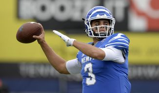 FILE - In this Oct. 13, 2018, file photo, Memphis quarterback Brady White warms up before an NCAA college football game against Central Florida, in Memphis, Tenn. Brady White has two seasons of eligibility remaining, yet he already has earned his master's degree. White now is working toward his doctorate while leading Memphis into its season opener Saturday against Mississippi. (AP Photo/Mark Zaleski, File)