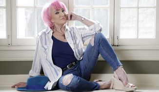 """In this Aug. 20, 2019, photo, Tanya Tucker sits for a portrait session in Nashville, Tenn., to promote her new album, """"While I'm Livin', """" out on Friday, (AP Photo/Mark Humphrey)"""