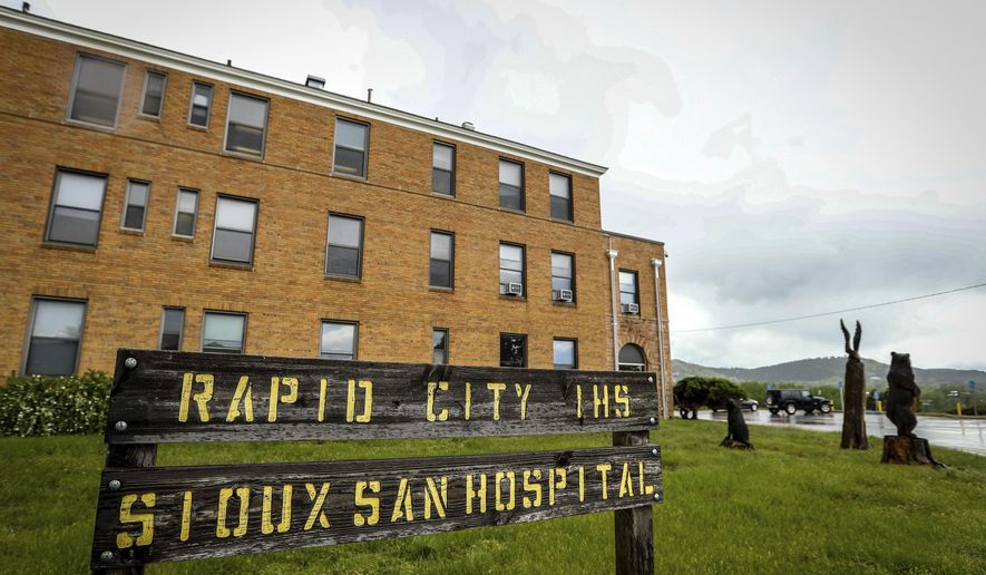 FILE - In this June 11, 2019 file photo showing the Sioux San Hospital in Rapid City, S.D. The federal agency that administers health care for Native Americans has long been plagued with problems that have kept it from improving in its delivery of health care to the more than 2.5 million people who depend on it. Money, staffing, infrastructure, health disparities and a general lack of accountability all have played a part. (Adam Fondren/Rapid City Journal via AP,File)