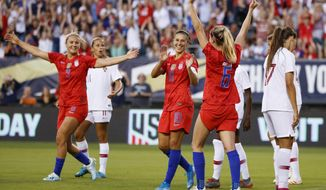 United States' Morgan Brian (6), Carli Lloyd (10) and Lindsey Horan (9) celebrate after a goal by Brian during the first half of the team's international friendly soccer match against Portugal, Thursday, Aug. 29, 2019, in Philadelphia. (AP Photo/Matt Slocum)