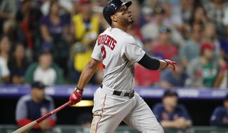 Boston Red Sox's Xander Bogaerts watches his solo home run off Colorado Rockies relief pitcher Carlos Estevez during the seventh inning of a baseball game Wednesday, Aug. 28, 2019, in Denver. (AP Photo/David Zalubowski)