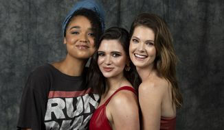 """This July 11, 2019 photo shows cast members Aisha Dee, from left, Katie Stevens and Meghann Fahy posing to promote Freeform's """"The Bold Type"""" in Burbank, Calif. (Photo by Willy Sanjuan/Invision/AP)"""