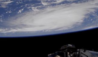 This Thursday, Aug. 29, 2019, image provided by NASA shows a view of Hurricane Dorian from the International Space Station as it churned over the Atlantic Ocean north of Puerto Rico. Leaving mercifully little damage in its wake in Puerto Rico and the Virgin Islands, Hurricane Dorian swirled toward the U.S., with forecasters warning it will draw energy from the warm, open waters as it closes in. (NASA via AP)
