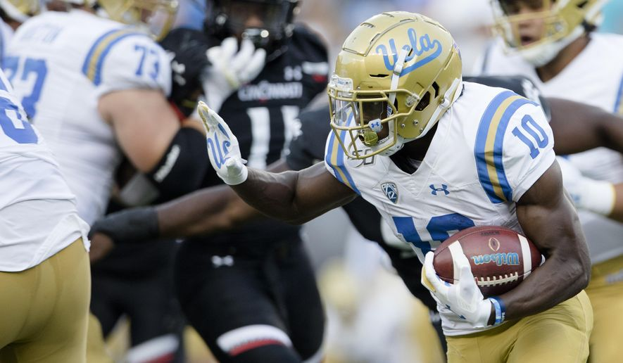 UCLA wide receiver Demetric Felton (10) runs with the ball against Cincinnati during the first half of an NCAA college football game Thursday, Aug. 29, 2019, in Cincinnati. (Albert Cesare/The Cincinnati Enquirer via AP)