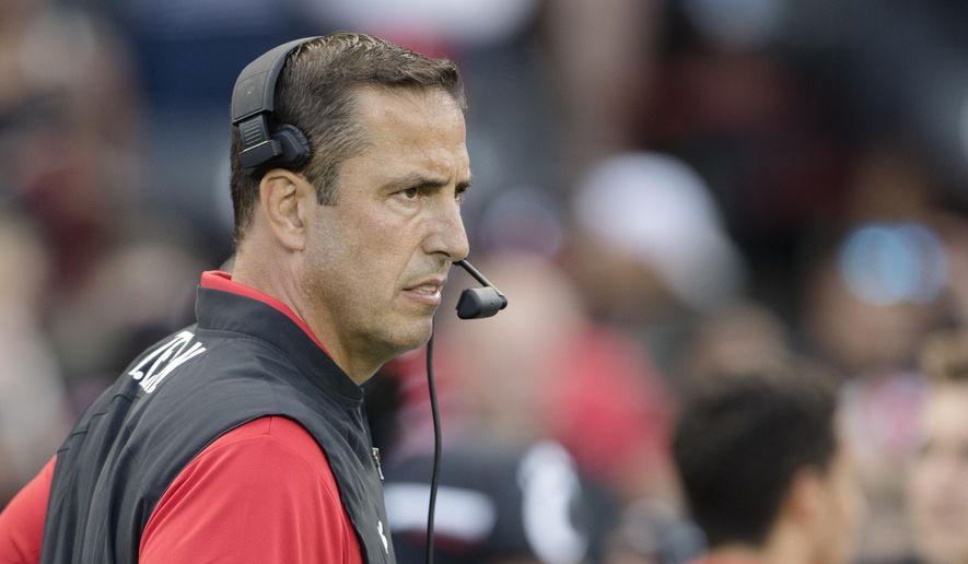 Cincinnati coach Luke Fickell watches players get ready for the team's NCAA college football game against UCLA on Thursday, Aug. 29, 2019, in Cincinnati. (Albert Cesare/The Cincinnati Enquirer via AP)