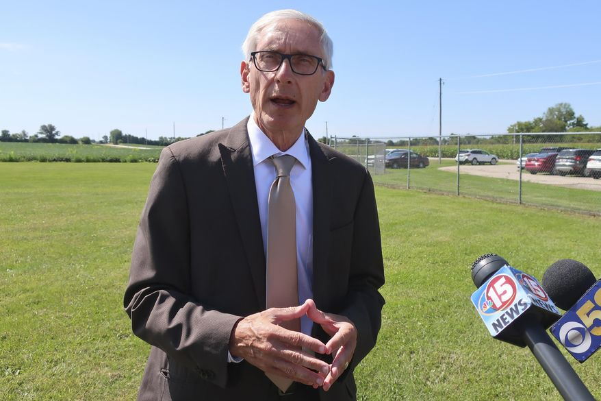 Gov. Tony Evers says he doesn't fault Republicans for not wanting to sign confidentiality agreements as requested by fellow Democratic Attorney General Josh Kaul on Thursday, Aug. 29, 2019, in Beaver Dam, Wisconsin. Evers told reporters that Republicans who stand in the way of Kaul settling lawsuits on behalf of the state need to figure out a resolution so Wisconsin does not lose millions of dollars in settlement money. (AP Photo/Scott Bauer)