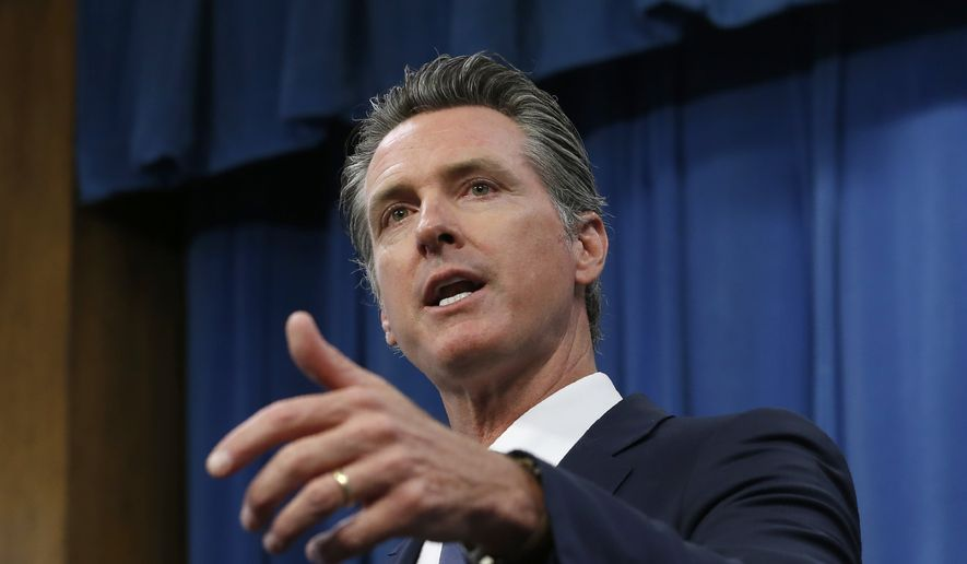 In this July 23, 2019, file photo, Gov. Gavin Newsom talks to reporters at his Capitol office, in Sacramento, Calif. (AP Photo/Rich Pedroncelli, File)