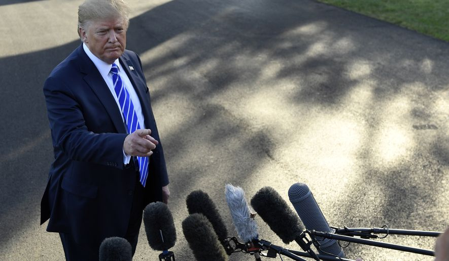 President Donald Trump talks to reporters on the South Lawn of the White House in Washington, Friday, Aug. 30, 2019, before heading to Camp David for the weekend. (AP Photo/Susan Walsh)